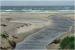 Mündung durch die Dünen in das Meer