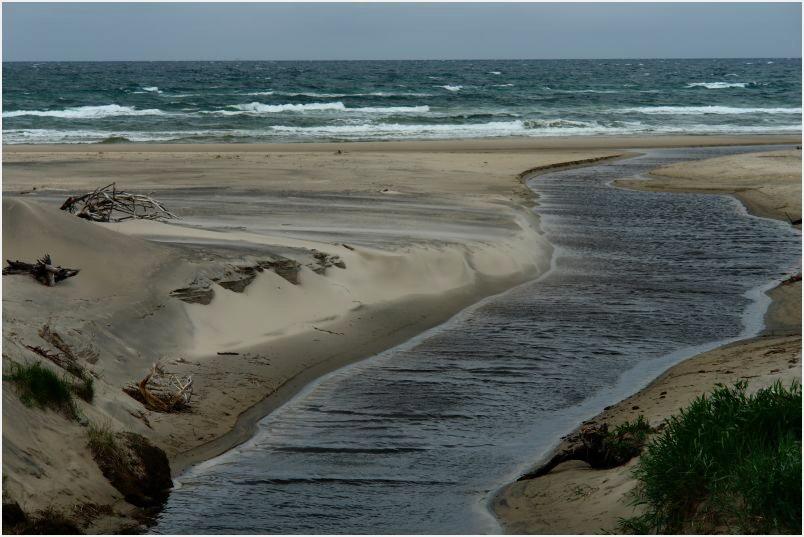 Treibsand verlegt an Dänemarks Küsten einen Flußlauf